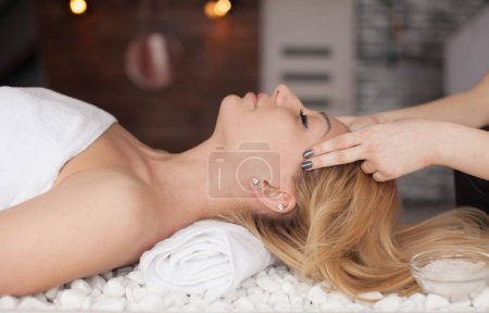 Photo for Face massage. Spa skin and body care. Close-up of young woman getting spa massage treatment at beauty spa salon. Facial beauty treatment. - Royalty Free Image