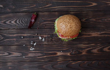 Photo for Delicious fresh homemade burger on a wooden table - Royalty Free Image