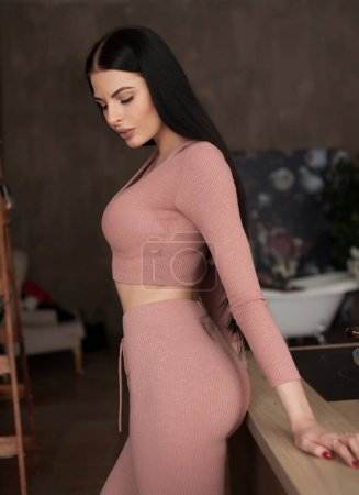Photo for Spontaneous attractive young brunette woman enjoying a good laugh at home in the apartment - Royalty Free Image