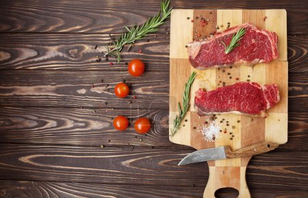 Photo for Raw steak on cutting board - Royalty Free Image