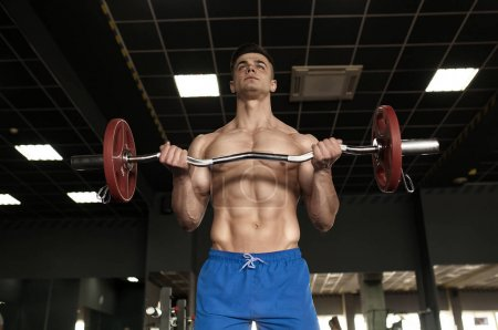 Photo for Sexy strong bodybuilder athletic fitness man pumping up abs muscles workout bodybuilding concept background - muscular bodybuilder handsome men doing fitness health care exercises in gym naked torso - Royalty Free Image