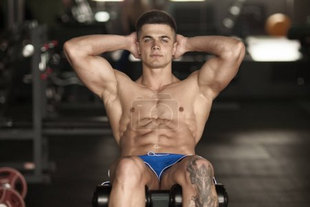 Photo for Exercising Abs Abdominals In Fitness Club - Royalty Free Image