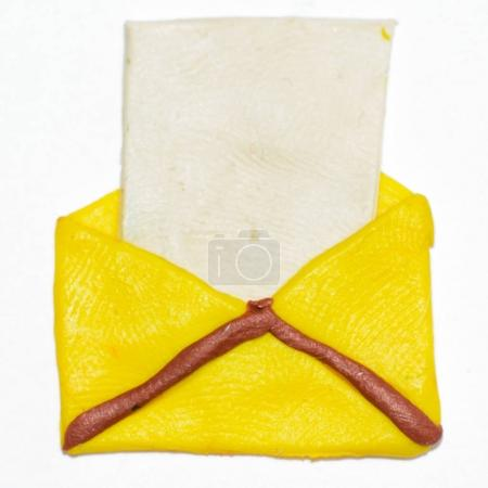 White sheet of paper in a yellow envelope
