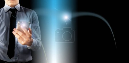 Photo for Half-length shot of faceless businessman isolated on the digital background and holding a cell phone in his hand and a light spark coming through it.With some icons also. - Royalty Free Image