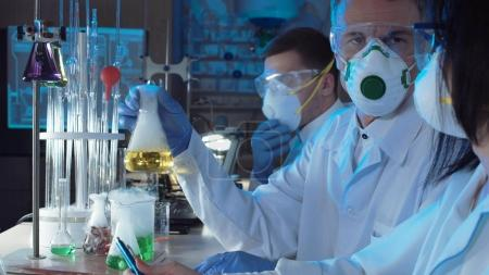 Group of chemists working in a laboratory
