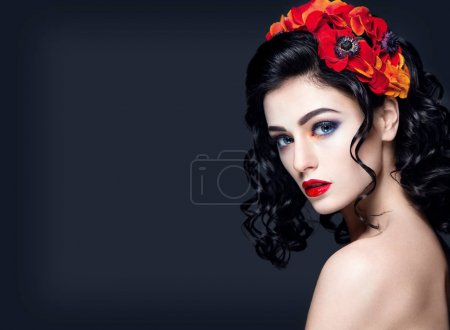 Young girl with red flowers in hair