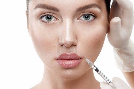 Beauty woman making injection