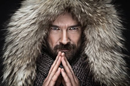 Man with beard in winter clothes
