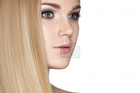 Portrait of blonde model with smooth long hair on white background