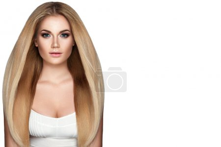 Portrait of young woman with straight blond hair on white background