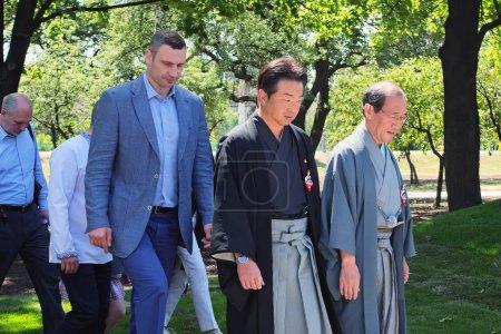 KYIV (KIEV), UKRAINE - 04 JUNE 2017: Official opening of the Kyoto Park in Kiev. Mayor of Kiev Vitali Klitschko and Mayor of Kyoto Daisaku Kadokawa inspect the park after reconstruction