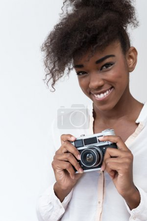 Afro american woman with vintage camera