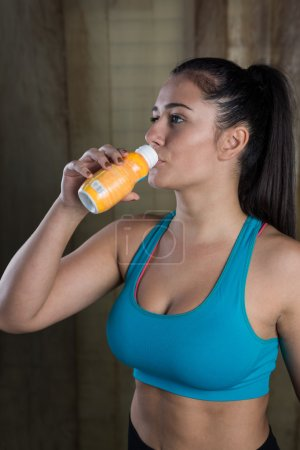 Fitness woman drinks energy drink