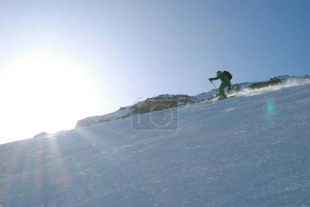 male skiing in mountains