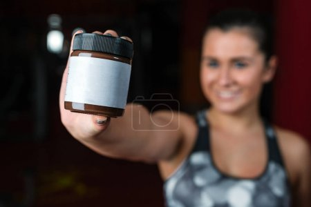 Woman holding a product with copyspace for the placement of your products