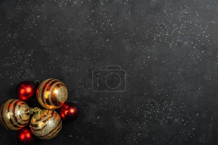 Christmas baubles on black background