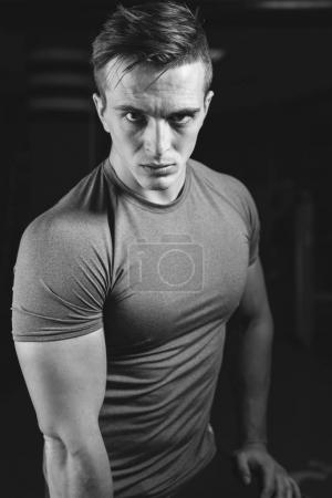 muscle man posing on gym