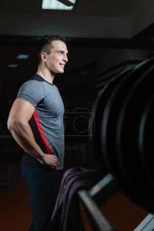 Athletic man training in gym