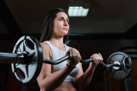 Athletic woman training in gym