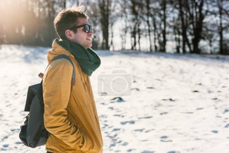 Young man in winter forest