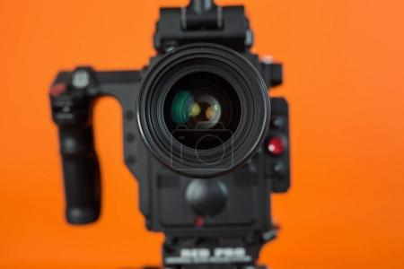 Professional video camera on vivid color background making contrast