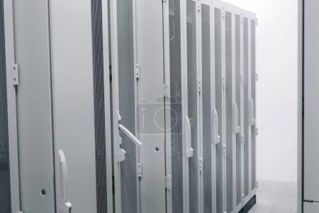 White Server Room Network/communications server cluster in a server room