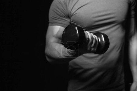 Bodybuilder with equipment portraits in studio