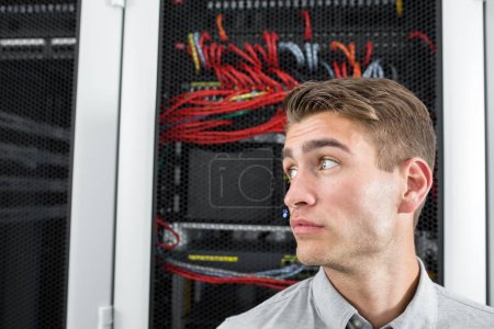 portrait of young man in modern data center
