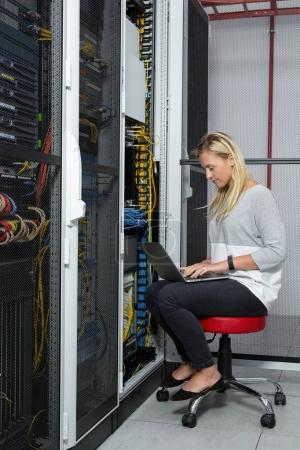 Portrait of a female executive in server room