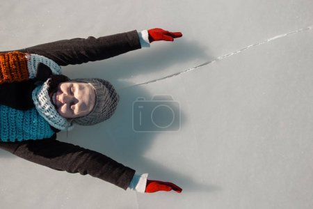 woman enjoying beautiful day on frozen lake