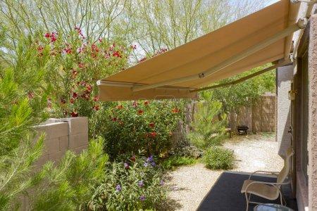 Arizona backyard with automatic retractable awning...
