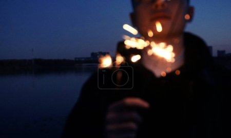 Photo for Silhouette of a man in a night city - Royalty Free Image