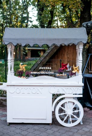 Cotton Candy cart with candy bar desserts and delicious sweets. Halloween decor.