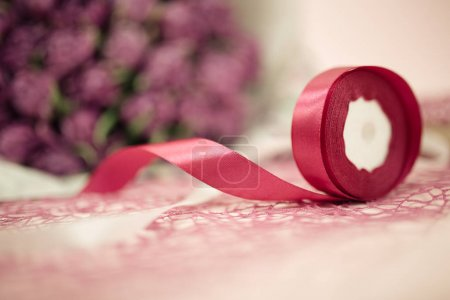 Still life of bouquet tape and violet flowers background