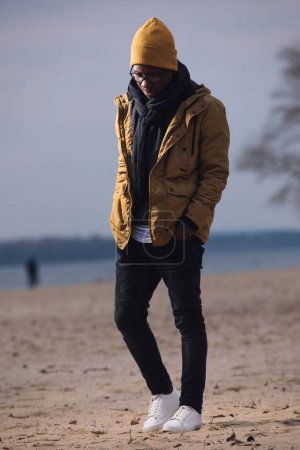 Photo for Depressed man standing alone on winter beach - Royalty Free Image