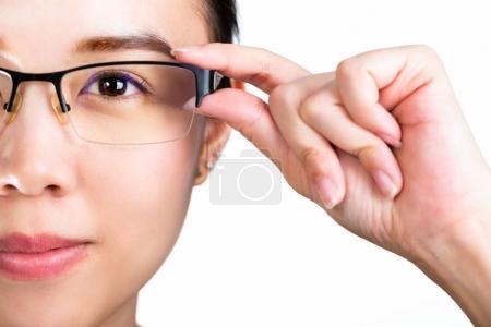 Eyeglasses. Woman wearing eyeglasses isolated whit...
