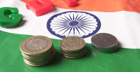 Photo for GST concept, GST alphabet and indian coins on Indian Flag background, business and financial india. Investment Saving and Corruption. - Royalty Free Image