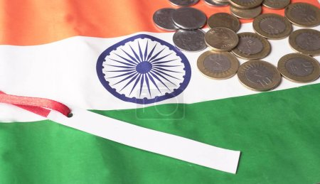 Photo for GST concept, indian coins on Indian Flag background, business and financial india. Investment Saving and Corruption. - Royalty Free Image