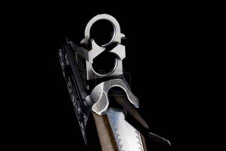 Open breach of double barrel shotgun isolated agai...