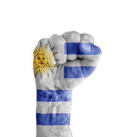 Photo pour Drapeau de l'Uruguay peint sur le poing humain comme symbole de victoire - image libre de droit