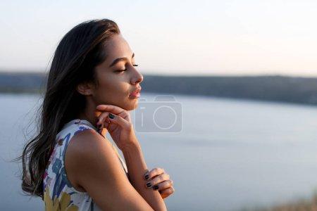 beautiful girl enjoying wind and breathing