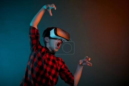 boy in VR headset gesturing
