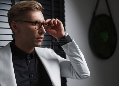 Fashionable man in glasses and suit