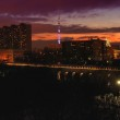 Постер, плакат: Night landscape of bridge aqueduct on the backround of Worker and collective farmer with the Ostankino tower at sunset Moscow Russia