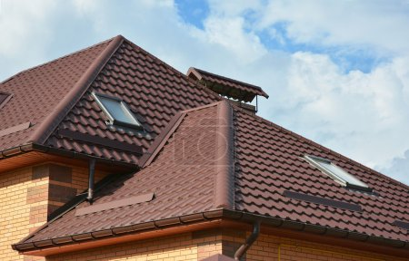 Roofing construction with attic skylights, rain gutter system, roof windows and roof protection from snow board, snow guard exterior.