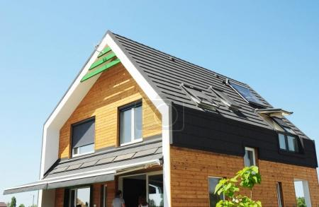 Modern Passive House Construction. Solar water heating (SWH) systems use roof solar panels. Home Skylights, Dormer. Eco Smart House Energy Efficiency. Attic skylight.