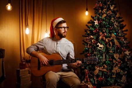 Man playing guitar in Christmas