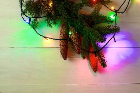 Christmas colorful lights frame on wooden table
