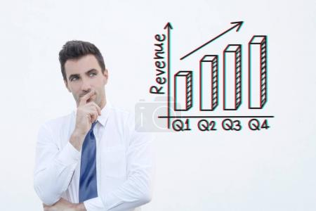 Businessman thinking about the increasing revenue on chart with RGB glitch effect. Stock Photo