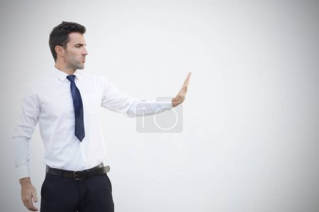 Photo for Businessman stop something on white background with copy space. Stock image - Royalty Free Image